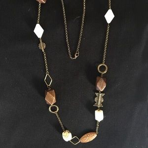 Long wood bead necklace. Brushed gold chain.